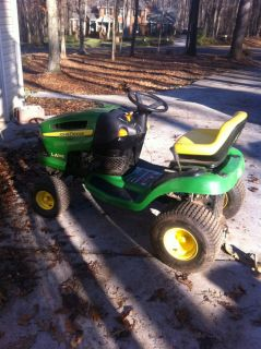 John Deere LA105 Riding Mower with Mower Deck Parts and Damaged Mower Deck
