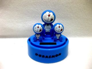 Brand New Three Doraemon Flip Flap Solar Powered