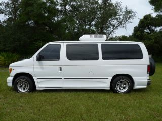 2000 American Vans Conversion Sleeps 2 Onan Generator Rooftop Air and Heat