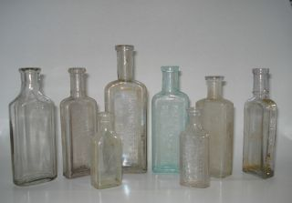 Lot of 8 Antique Apothecary Medicine Bottles Embossed w Pharmacy Cures