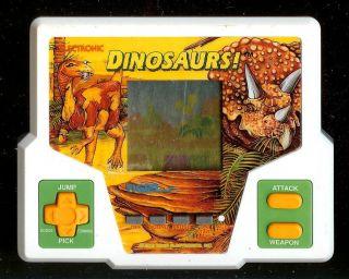★ 1990s Dinosaurs Tiger Electronic Handheld Vintage Pocket Arcade Video Game ★