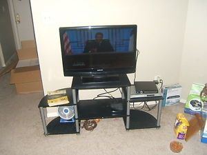 Magnavox TV 32 inch Flat Screen TV with TV Stand and Bonus DVD Player