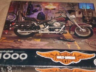 "Harley Davidson Official Licensed Product   1994 Puzzle Motorcycle in garage with gear, leathers and tools   1000 interlocking pieces   when assembled is full 24"" x 30""   Part Number PZL6183. Does not identify model. Hallmark Books"
